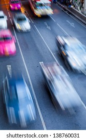 Evening Motion Blur of Fast Cars traffic on road