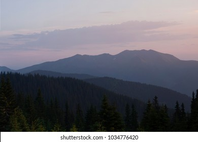 evening mountain landscape, beautiful pink purple sunset twilight landscape
