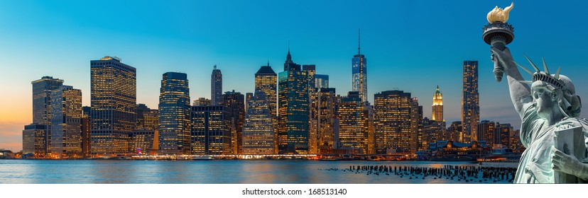 Evening New York City skyline panorama and The Statue of Liberty