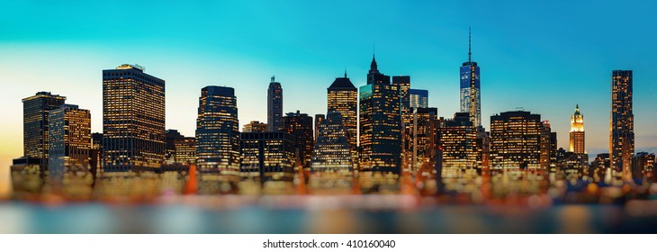Evening New York City skyline panorama with blurred foreground