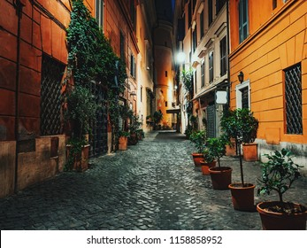 Evening or night view of old cozy street in Rome, Italy. Cityscape of italian capital with nobody.