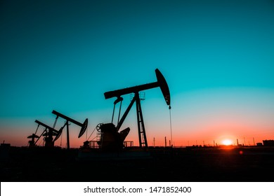 In the evening oil field, the pump is running.