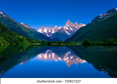 Evening on the lake in the mountains in the summer. Russia. Dombay.