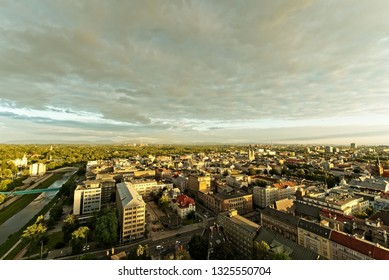 Evening Ostrava city from above from town hall tower. City scape  with river Ostravice, metal works and Beskydy moutains in bavkground in evening golden hour.