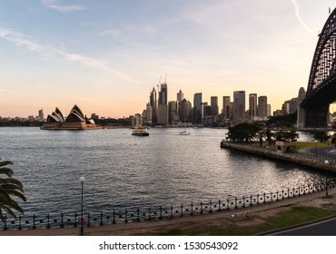 Evening over the famous Sydney harbor and the business district in Australia largest city