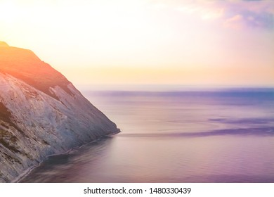 Evening over a high and steep seashore.