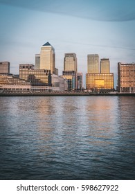 Evening panorama at the golden hour of the Canary Wharf, the major business district located in Tower Hamlets, East London. Famous skyscrapers and landmarks of the London.