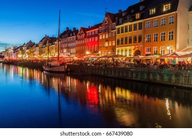 Evening panorama of Nyhavn district architecture in the Old Town of Copenhagen, Denmark