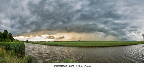 Evening panorama of a storm with arcus cloud over the dutch landscape