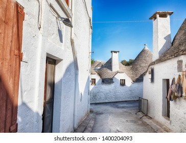 evening panorama of street in Alberobello village  with gabled (trullo) roofs, Puglia, Italy