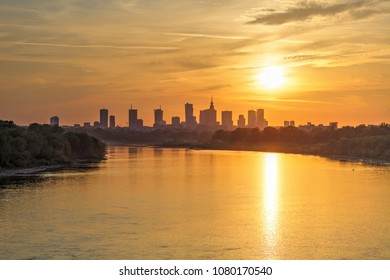 Evening panorama of Warsaw skyline, Poland, over Vistula river at sunset