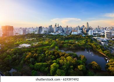 Evening period cityscape at Lumpini park, Bangkok skyline Thailand