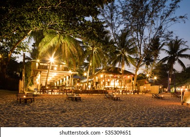 Evening Phangan beach glowing lights or bars and restaurants