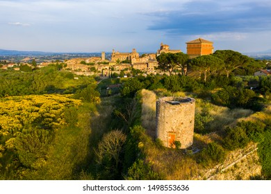 Evening photo of small historic town Lucignano in Tuscany from above along with old Medici fort tower, Italy