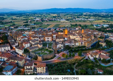 Evening photo of small historic town Monte San Savino Tuscany from above, Italy