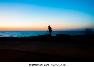 Evening photography. Golden hours shoot. Sunset above the sea in Tel Aviv. Working photographer.