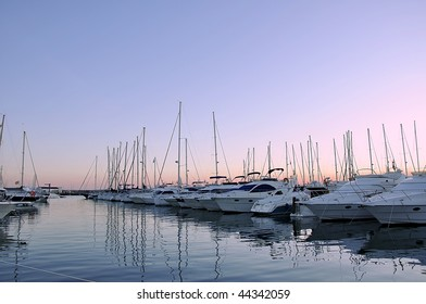 Evening port. Yachts on a mooring.