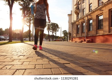 Evening run. Walking. Healthy and happy woman. Sports, exercise, healthy body, muscles, thirst, drink, heat, summer rushing, hike, evening run, happiness in small things, be happy, be free. Be happy.
