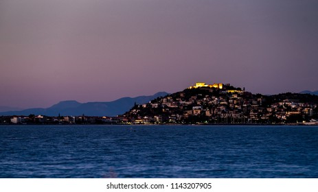 Evening scene of Astros town with old ruined Castle of Zafeiropouloi, Greece Peloponnese Arcadia. Travel adventure concept