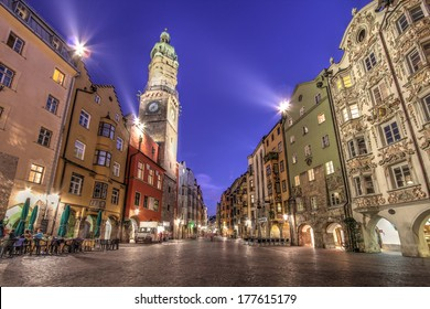 Evening scene in central Innsbruck, Austria along the famous Herzog-Friedrich scene with the Stadtturm (City Tower) and other famous historical houses.
