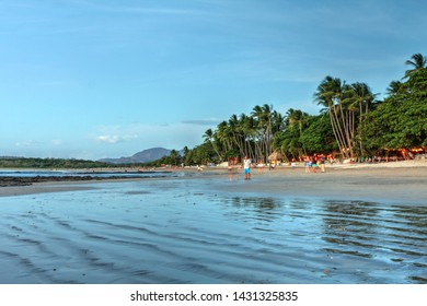 Evening scene on Tamarindo beach under low tide in Guanacaste, Costa Rica.