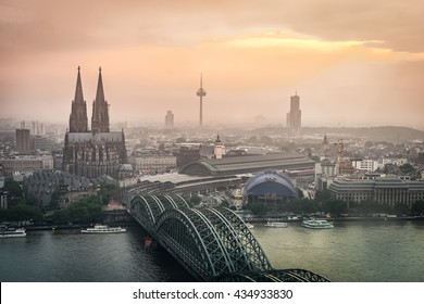 Evening scene over Cologne/Koln city with Kolner Dom/Cathedral behind the Hohenzollern bridge and Koln towers