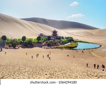 Evening scenery of the famous crescent-shaped of oasis lake and beautiful pagoda in Gobi desert, Dunhuang, China.