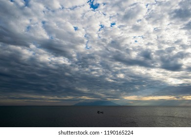 An evening shot of a cloudy landscape at Alexandroupolis, in which we can see Samothrace in the horizon.