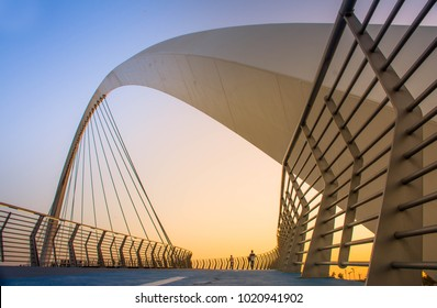 Evening shot of Dubai FamousWater Canal Bridge New Attraction of Dubai City, place to visit in UAE, tourist place in Dubai, travel destination, modern architecture beautiful sunset at Tolerance Bridge