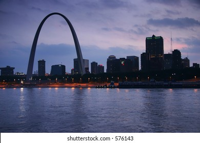 Evening shot of the St. Louis Gateway Arch in MO from across the Mississippi, in IL.  The view is over the river, and gives a nice skyline of St. Louis.