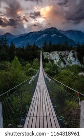 Evening shot of a wooden hanging bridge near the towns Susten and Leuk in Canton Wallis