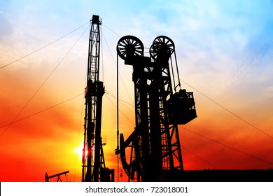 In the evening, the silhouette of oilfield derrick