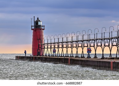 Evening skies begin to clear after a stormy afternoon at the South Haven, Michigan Lighthouse on Lake Michigan.