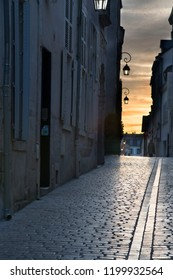 Evening sky against a cobblestone street in Paris