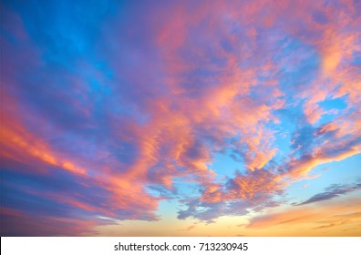 Evening sky with amazing colorful beautiful pink yellow and blue sunset cloud on twilight.
