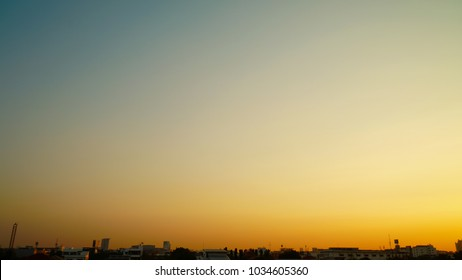Evening sky with buildings silhouettes, Twilight sky background on cityscape,  with copy space
