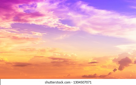 evening sky with cloudy and yellow orange sundown light and purple pink color light