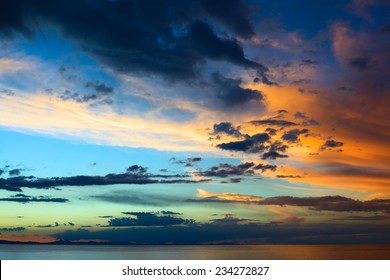 Evening sky with colorfully lit clouds shortly after sunset over Lake Titicaca viewed from the small tourist town of Copacabana in Bolivia