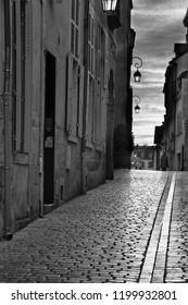 Evening sky on a cobblestone street in Paris in Black and White