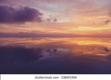 evening sky reflected in water