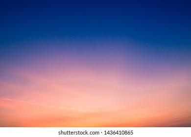 Evening sky,Amazing Colorful sky and Dramatic Sunset,Majestic Sunlight Cloud fluffy,Idyllic Nature Peaceful Background,Beauty Dark Blue Hour on Dusk Purple