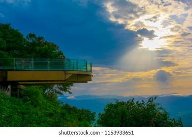 The evening skyline of dark, dark shadows with evening sunlight shines on Skywalk at Wat Pha Tak Sue .SangKhom District Nong Khai Province Thailand.