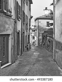 Evening small street Tuscany, Italy. Old-style, black - white photo.