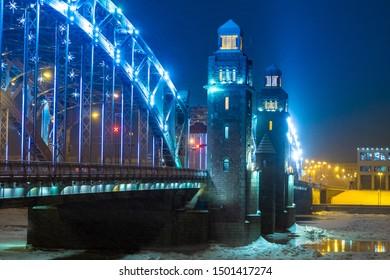 Evening St. Petersburg. Winter in Russia. Rivers Of St. Petersburg. Bridges Of St. Petersburg. The bridge across the river. Bolsheokhtinsky bridge. Peter The Great. Evening city lighting.