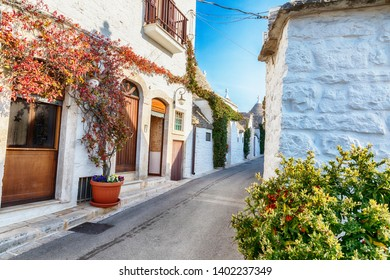 evening street in Alberobello village  with gabled (trullo) roofs, Puglia, Italy