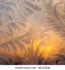 Evening Sun and Bright Blue Sky Through Frost Pattern on a Window