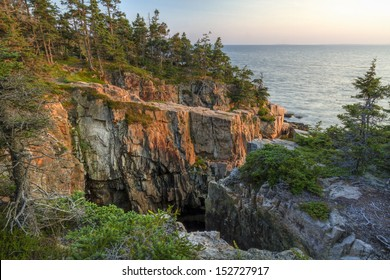 Evening sun hits an iconic Raven's Nest cliffs on the Schoodic Peninsula in Acadia National Park, Maine