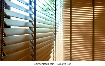 Evening sun light outside wooden window blinds, sunshine and shadow on window blind and Granite tile wall, decorative interior home concept