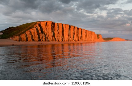 Evening sun on the famous East Cliff at West Bay, Bridport, Dorset, made famous from the Jurassic Coast World Heritage Site and the TV programme Broadchurch