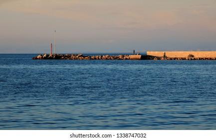 evening sun on the jetty in Rovenska, island Losinj, Croatia